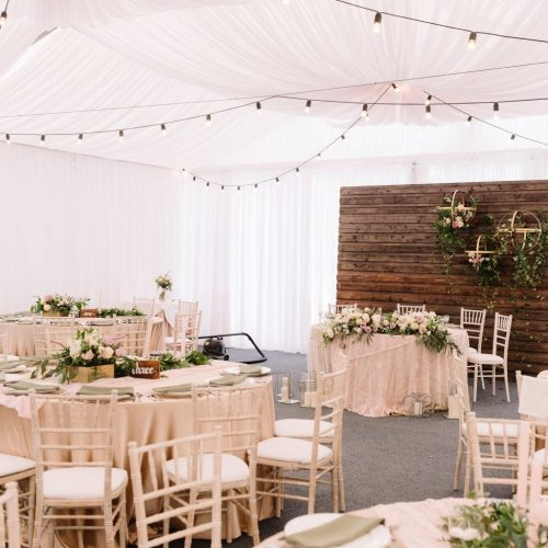 Interior of a wedding decorated restaurant in light colors and rustic style